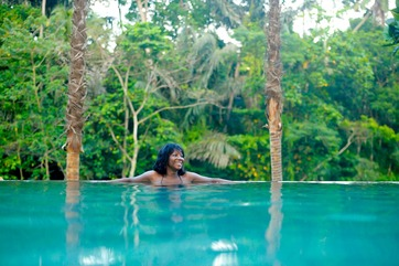 woman soaking in tropical spring